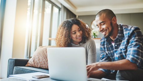 Young couple applying for a loan on their laptop