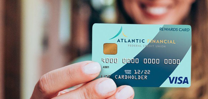 Woman holding an AFFCU Visa Credit Card