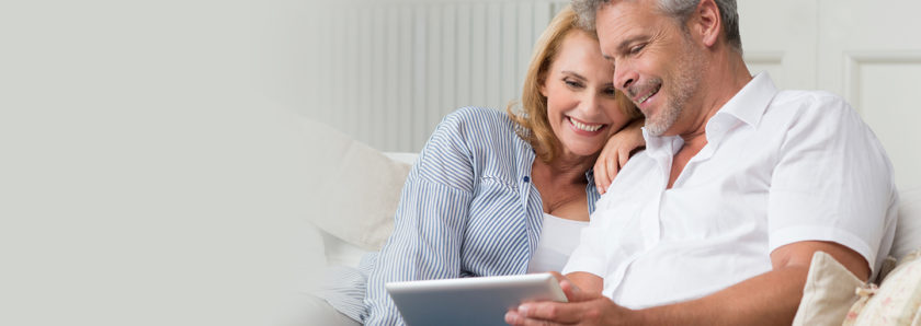 Couple checking finances on tablet