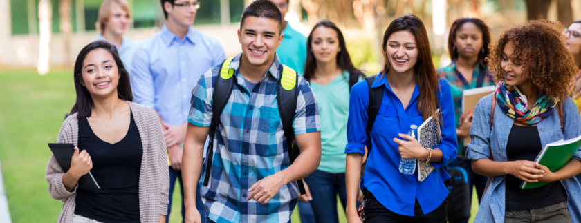 AFFCU Journey Account BAck to school deposit match - group of students walking across campus