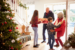 Children greeting grandparents at door for holidays