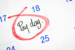 Calendar with Pay Day noted and circled