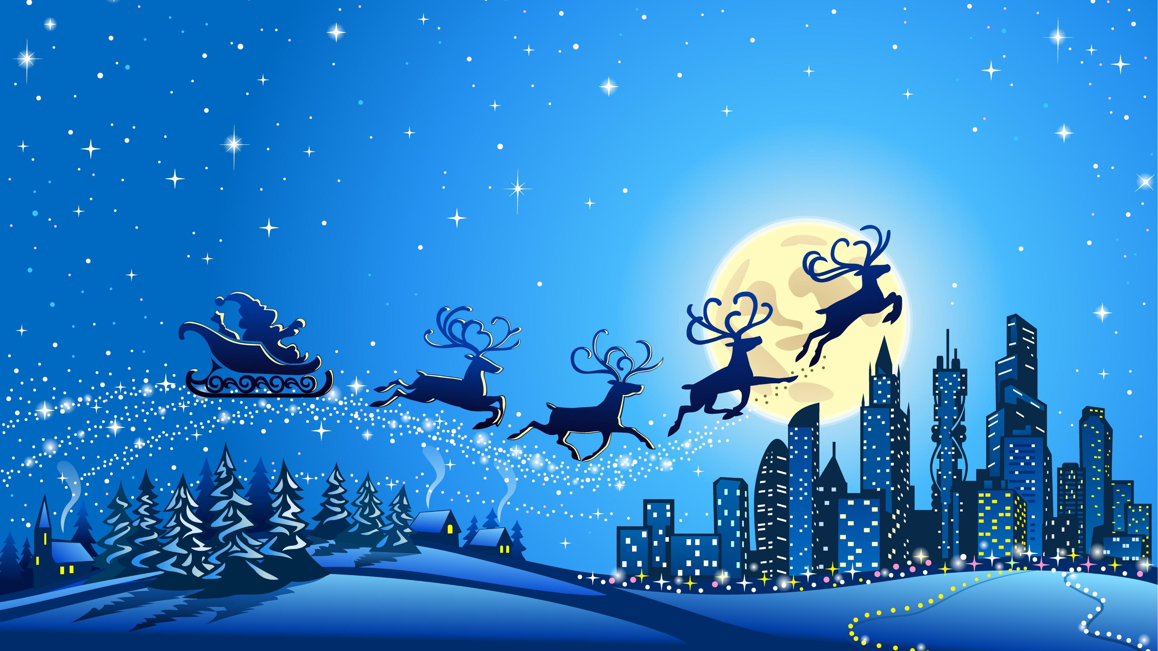 Snowy city image with sleigh and reindeer flying over
