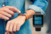 AFFCU Smart Watch App - Person using watch on arm