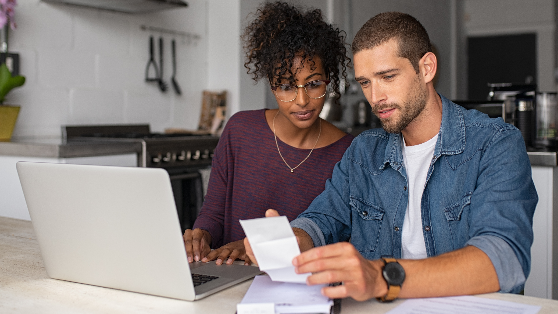 AFFCU Blog cover- young couple reviewing personal budget at laptop