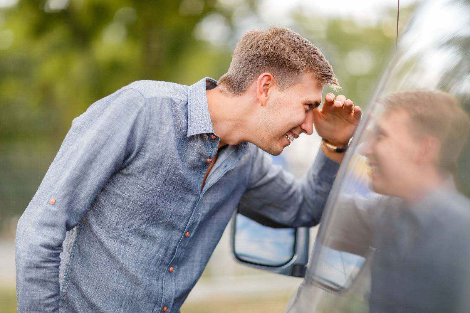 young man looking at used vehicle discovering what to know when buying a used car