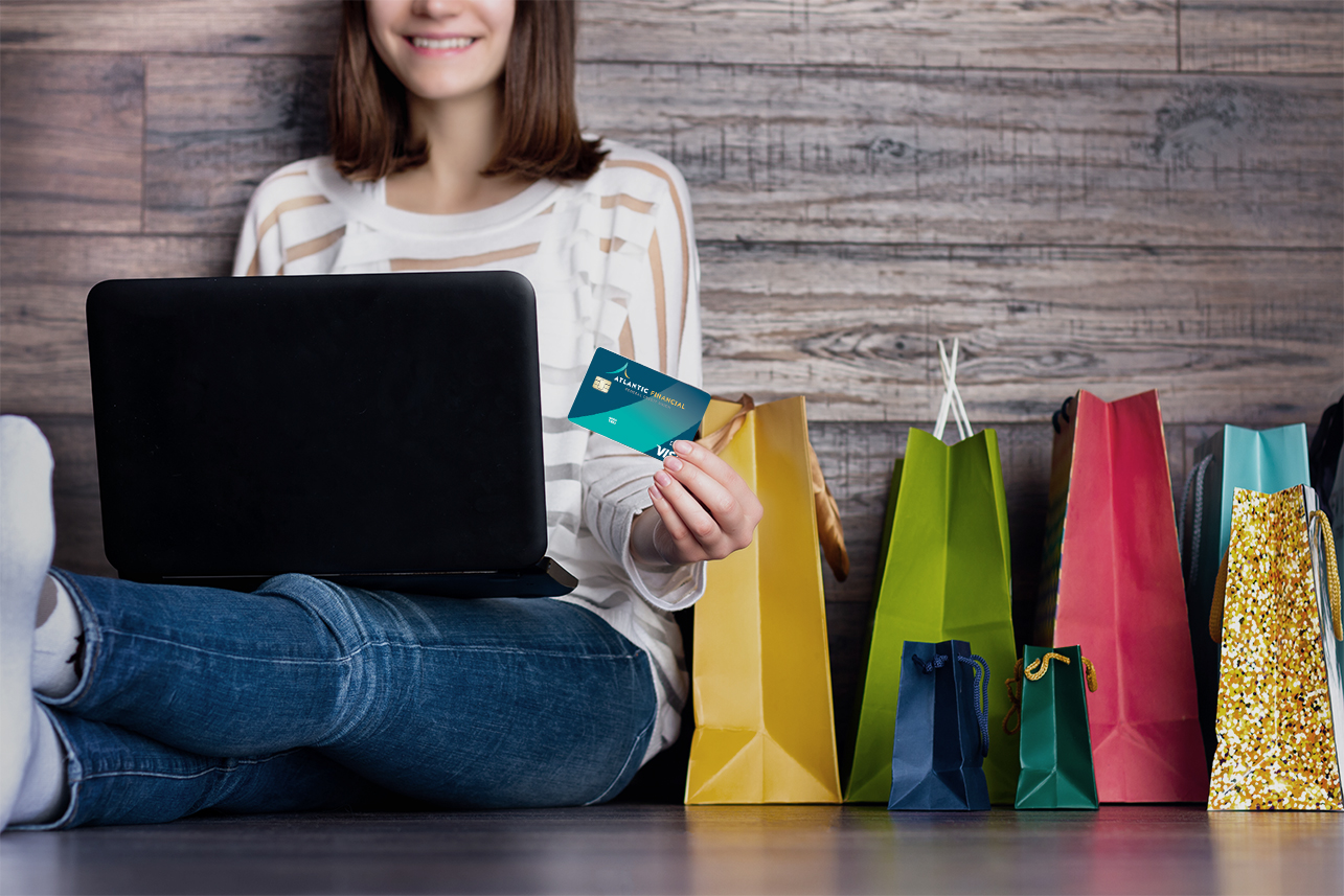Lady sitting on floor with laptop shopping online