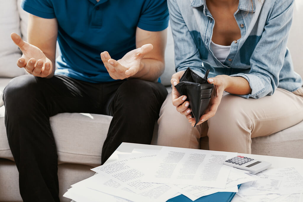 frustrated couple debating money management tips