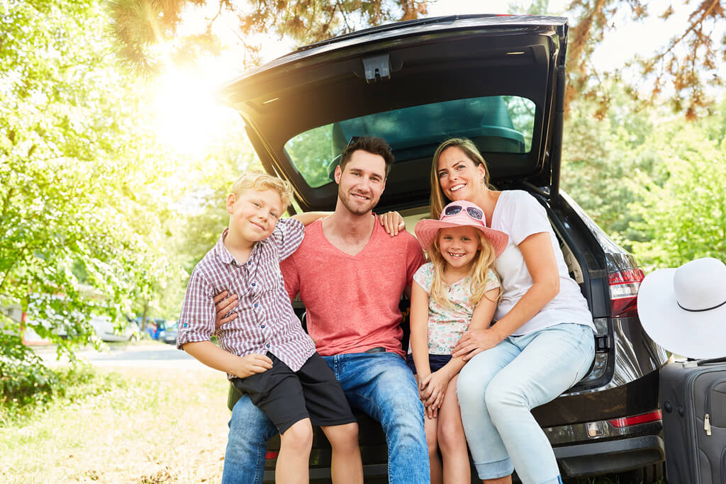 happy family driving off with new vehicle private seller car loan