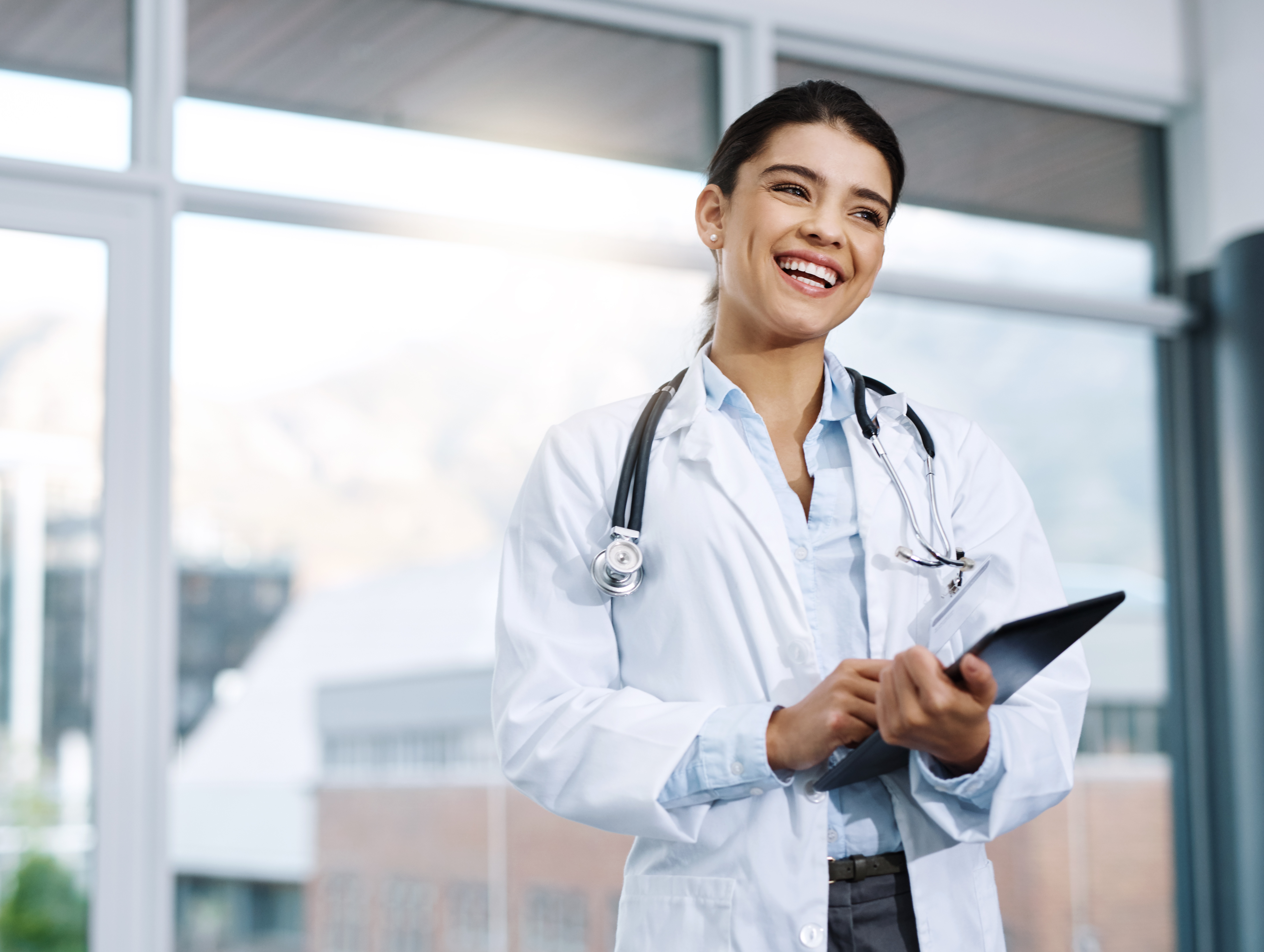 Smiling female doctor with tablet ready to meet with patient