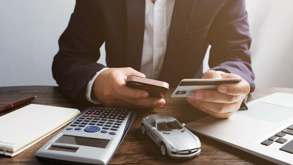 man considering if it's worth refinancing his car